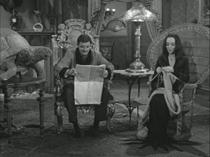 Gomez-and-Morticia-in-chairs-611x458
