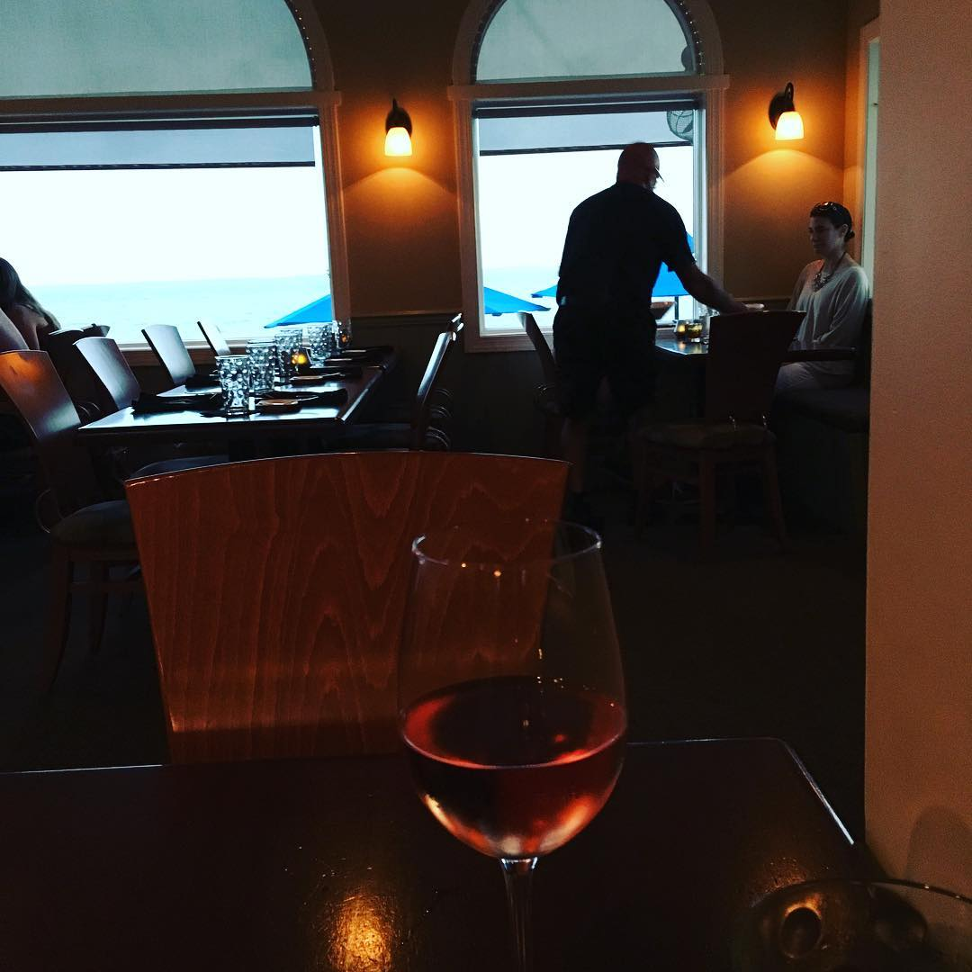 After nearly 6 hour drive, I am on the OBX. Celebrating with a cold glass of rosé. Come see me tomorrow 9-11 am @duckscottage, then 2-4pm in Manteo at @downtownbooksmto