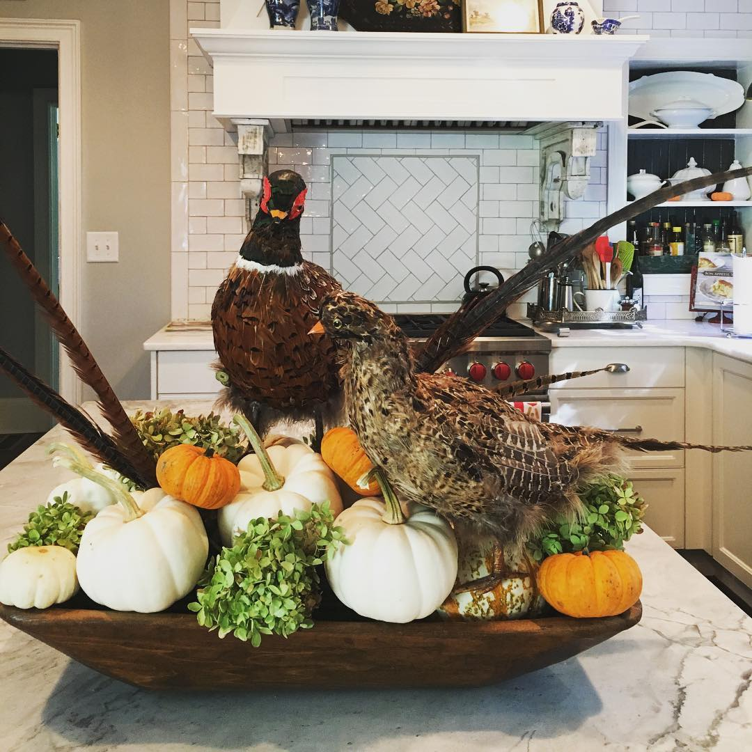 People always ask me what I do with all the junk I drag home. Today I went to an estate sale and picked up these ridiculous faux pheasants for $10. Took 'em home and stuck 'em in my antique dough bowl with some pumpkins and dried hydrangeas from the garden.  Cheap thrills